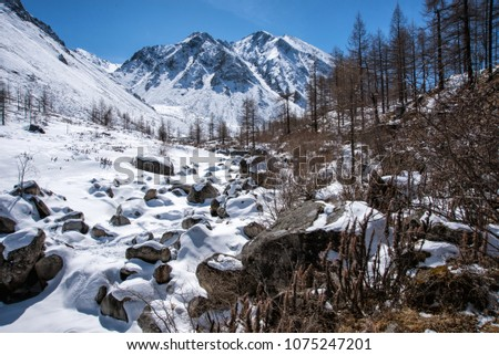 High mountains under snow in the winter #1075247201
