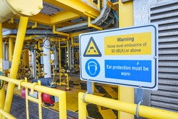 High noise alert sign, Protection equipment sign on offshore wellhead remote platform working area, Energy and petroleum industry.