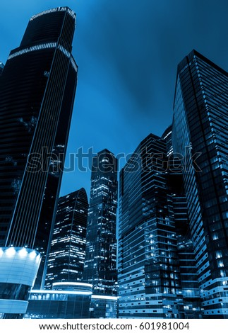 high of the modern business skyscrapers at night, the view from below. Blue tone #601981004