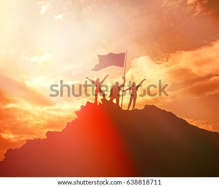High performance, silhouettes of three people, raise the flag and hands up. A man on top of a mountain. Conceptual design. Against the dramatic sky with clouds at sunset. Success business. #638818711