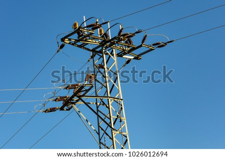 High power line is splitting in to three different ways. #1026012694