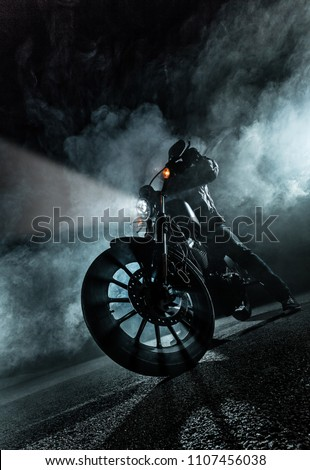 High power motorcycle at night. Smoke effect on dark background. #1107456038