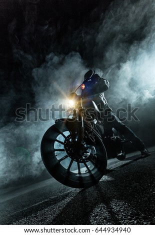 High power motorcycle chopper at night. Smoke on background. #644934940