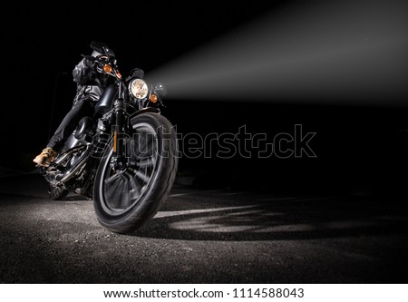 High power motorcycle chopper at night with shinning light.