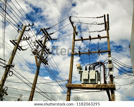 High-power transformers installed on concrete pillars. To convert the high voltage from the transmission line into a low voltage to the user.