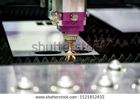 High precision CNC laser cutting metal sheet with bright sparkle in industrial factory #1121852432