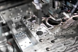 High precision CNC machining center working, operator machining automotive sample part process in industrial factory