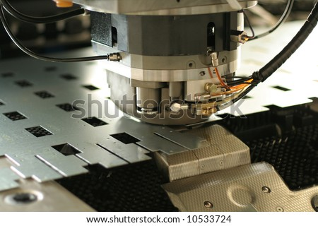 High precision CNC sheet metal stamping and punching machinery. Extreme close up