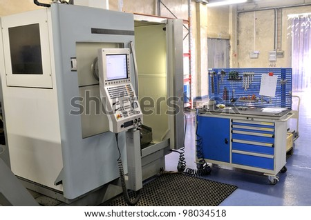 High precision lathe with control panel.
