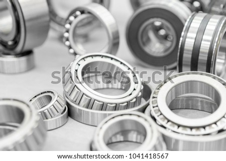 High precision machine parts bearing isolate on white background in workshop #1041418567