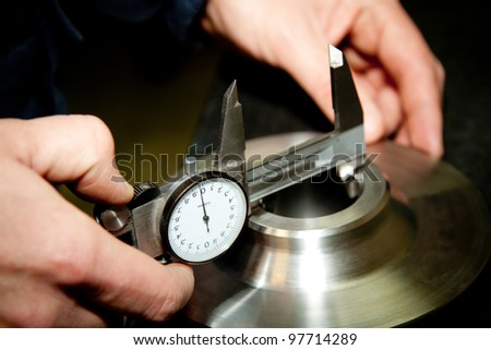 High precision measurement tools in a mechanics plant. Focus on the dial.