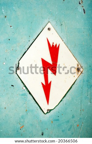 High pressure voltage, red mark of a lightning on a white rhombus, on a green background