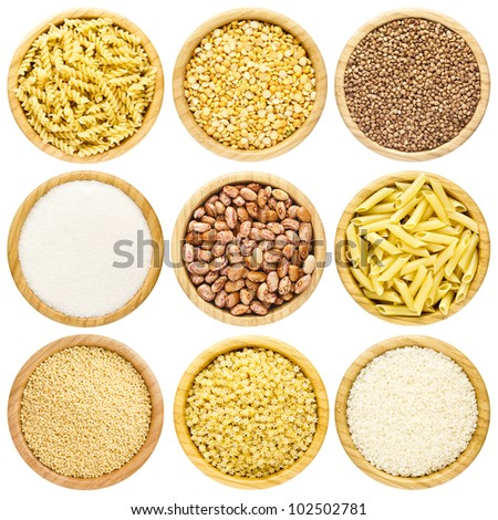 High Quality, Detailed Set or Collection of Dry Uncooked Pasta, Macaroni, Peas, Buckwheat, Sugar, Haricot, Millet and Rice Cereals in a round Bamboo Serving Bowl isolated on the white background