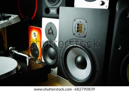 High quality loudspeakers in dj shop.Buy hifi sound system for sound recording studio.Professional hi-fi cabinet speaker box on sale.Audio equipment for audio record studios #682790839