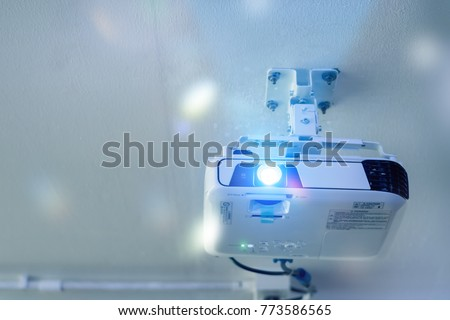 High quality Projector(4K) at the ceiling in conference room with copy space.Projector at business conference or lecture.For offices and training facilities. Irradiation.