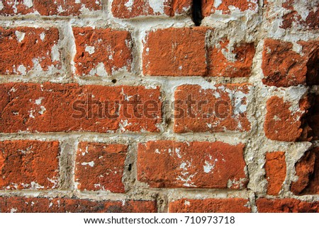 high quality texture of oldest red brick masonry with white cement mortar closeup