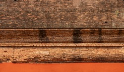 High-resolution ancient brick wall. Buddhist temple old brick wall with peeling paint. Antique brickwork. Ancient brickworks. Orange fabric. The part of the Buddhist stupa old wall. Front view