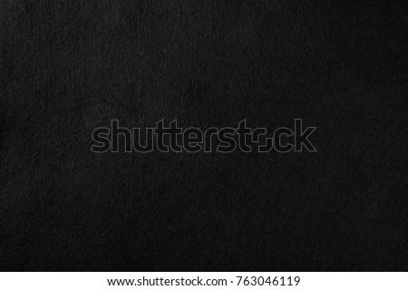 High resolution black texture felt texture fiber natural wool pattern background. Real black felt wool textile texture pattern background felted cloth texture pattern natural abstract background