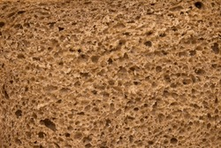 High resolution brown bread texture background. Texture of brown bread baked from rye flour