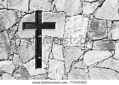 High resolution Christian cross over an old stone wall