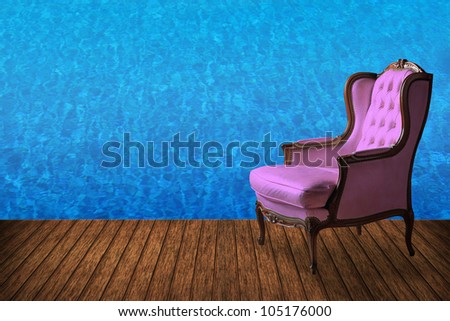 High resolution creative wood floor with vintage armchair and swimming pool background