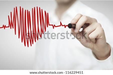 Shutterstock High resolution man drawing chart heartbeat