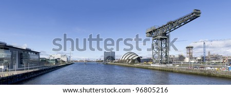 High resolution panorama of the River Clyde in Glasgow showing Finnieston Crane, Armadillo, Bell's Bridge and Science Tower.