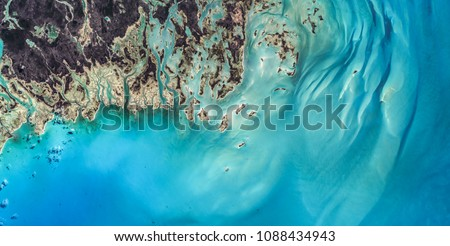 High resolution satellite image of caribbean coast, coral reef and sand structures of Bahamas, Caribbean from above, aerial view, natural background, contains modified Copernicus Sentinel data [2017]