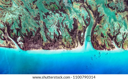 High resolution satellite image of Caribbean island coast with coral reefs and water stream structures from above, aerial view, contains modified Copernicus Sentinel data [2018]