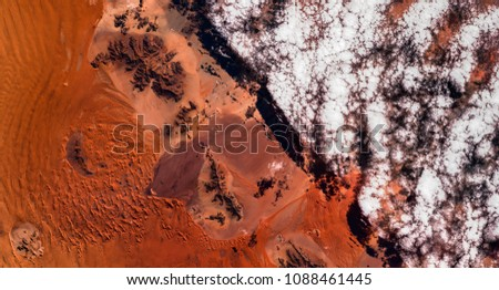 High resolution satellite image of cloud boundary in Namib desert from above, Namibia, Africa, natural background texture, aerial view, contains modified Copernicus Sentinel data [2018]