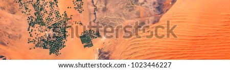 High resolution satellite image of irrigated agriculture and dried out riverbeds in the desert of Saudi Arabia, Tuwaiq Escarpment, contains modified Copernicus Sentinel data [2018]