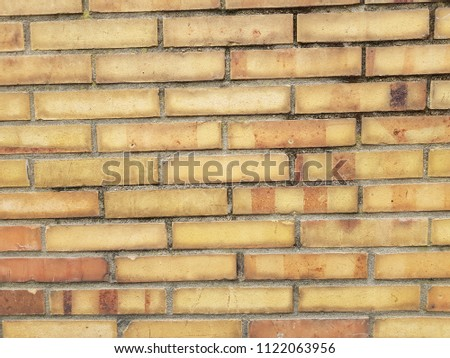 High Resolution Texture Of A Yellow Brick Wall Background In The