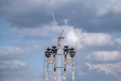 high-rise bridge pylons under construction. Construction crane on the background of the sky. Construction site.