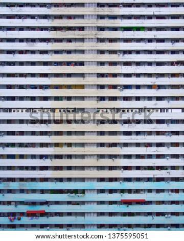 High rise building flat facade. Corridors and windows of a skyscraper