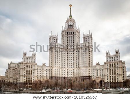 High-rise building on the waterfront promenade in Moscow. Skyscraper on the waterfront promenade. Moscow sights - Vysotka na Kotel'nicheskoy naberezhnoy Stock photo ©