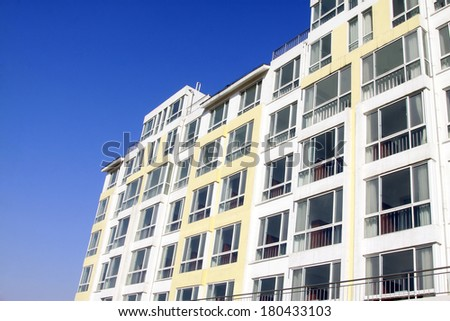 high rise buildings in the blue sky, closeup of photo