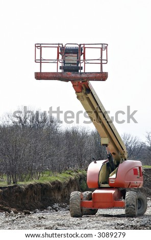 High rise cherry picker on construction site