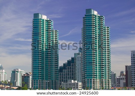 High rise Condo Tower against a blue sky
