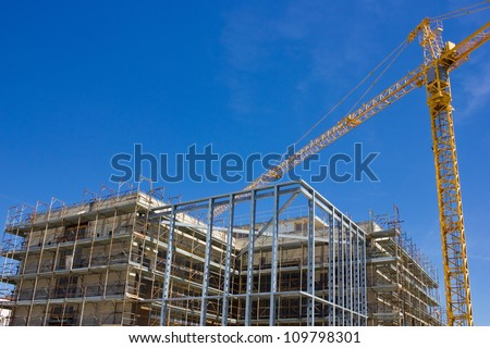 High rise construction and crane
