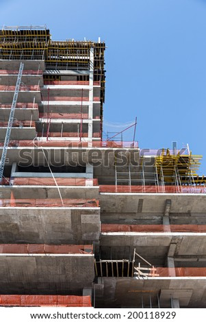 High rise construction site with a concrete structure in the process of being built