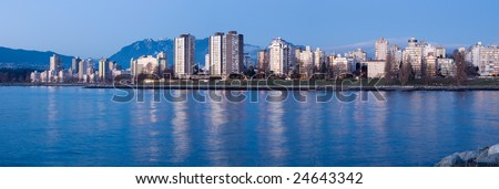 High-rises at English Bay, Vancouver, Canada are lit by the last rays of setting sun.