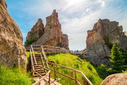 High rocks in the Carpathian mountains, nature landscape, ruins of Tustan fortress.