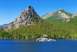 High scaur Okzhetpes and mysterious sphinx Zhumbaktas (puzzle-stone) on Lake Auliekol (Borovoe) are located in Burabay National Nature Park in the Republic of Kazakhstan. Beautiful mountain landscape.