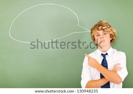 high school boy pointing at chat box drawn on blackboard