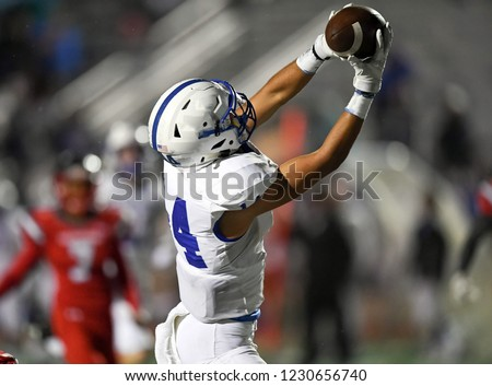 High School Football player in action during a game in South Texas