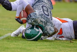 High school football player in for the touchdown.