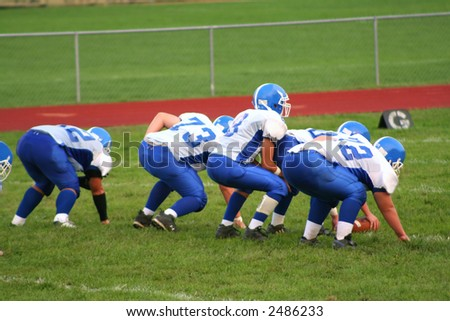 High school football players during a game.