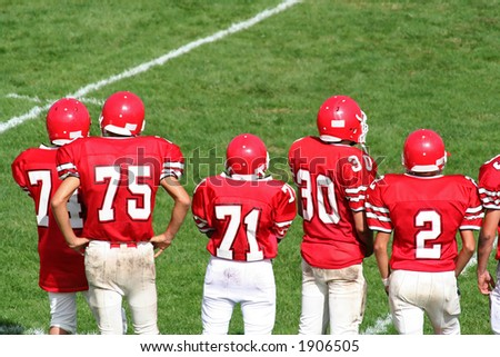 High School Football Team on Sidelines