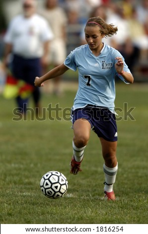 stock photo : high school girl soccer player about to make a move with the