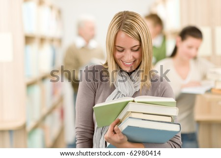 High school library - happy female student with book read